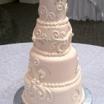 pink scroll wedding cake - haute cakes austin